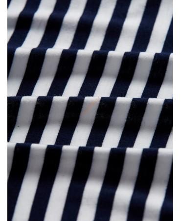 Sleeveless dress with multi-striped v-neck hem
