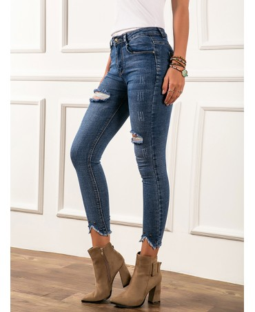 Stylish blue jeans with ripped details and extra stretch