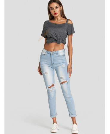 Stylish blue random ripped detail five pockets of bleached jeans