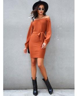 A knit dress with an orange off-the-shoulder belt
